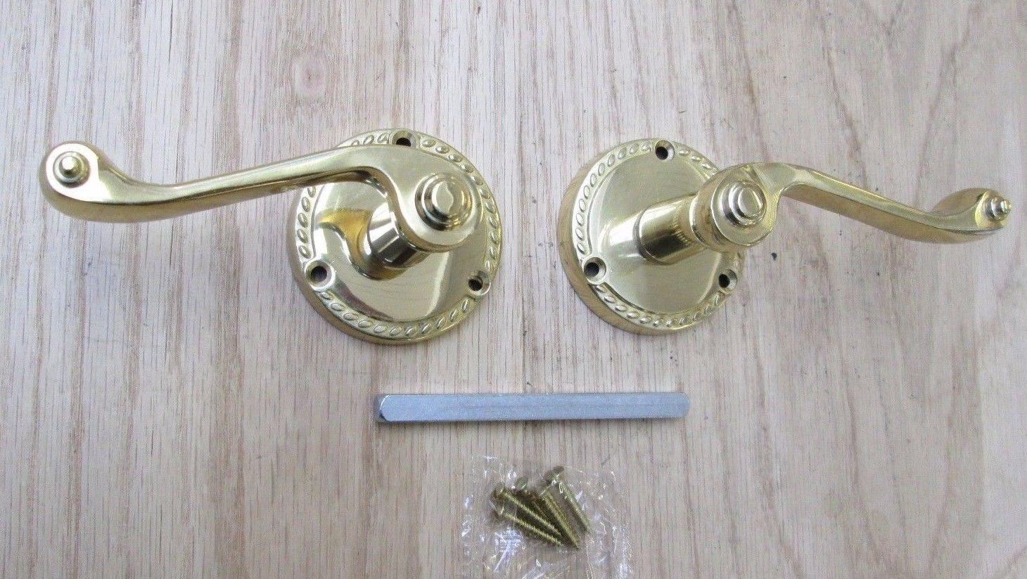 ironmongery world polished brass georgian lever on rose. Black Bedroom Furniture Sets. Home Design Ideas