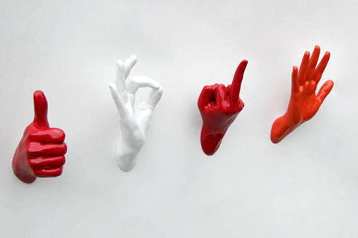 wall hooks made from modelled hands in different gestures