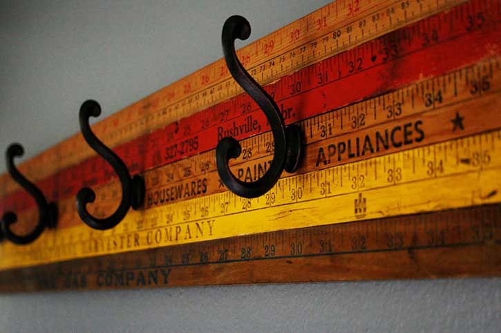 coat rack made from vintage yardsticks