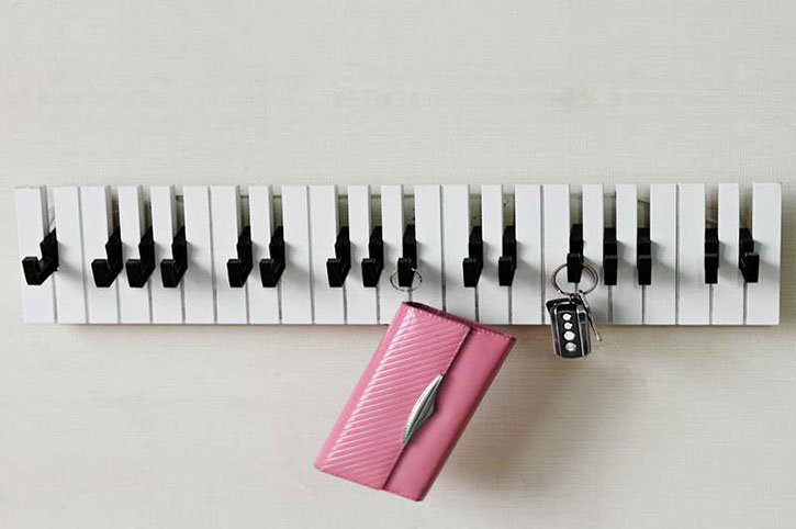 wooden coat rack made to look like piano keys