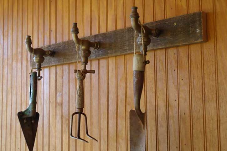 wooden coat rack made from garden taps