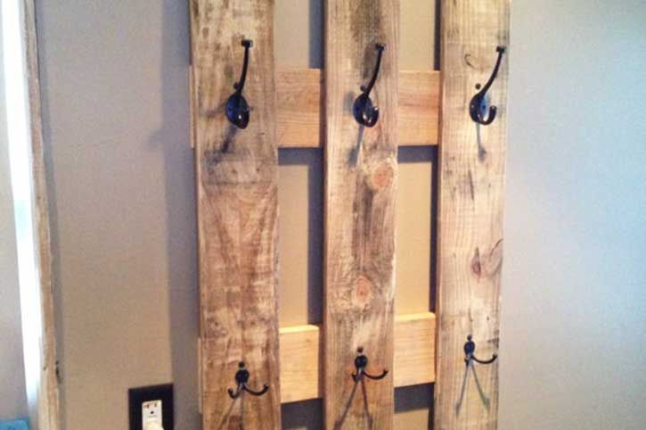 coat rack made out of a wooden pallet